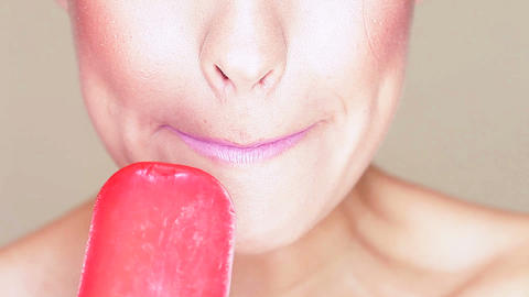 Woman licking an icecream lolly Stock Video Footage