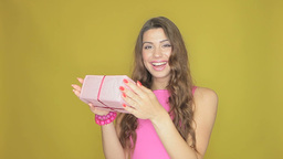 Happy woman receiving a gift Stock Video Footage