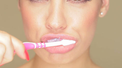 Beautiful woman with toothbrush Stock Video Footage