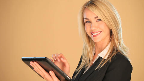 Blonde businesswoman on a tablet Stock Video Footage