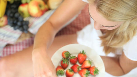Woman enjoying eating a strawberry Stock Video Footage