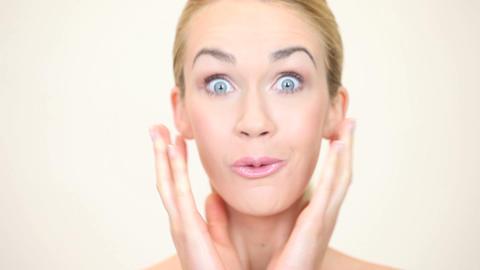 Shocked blonde woman Stock Video Footage