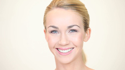 Blonde woman smiling facing forwards Footage