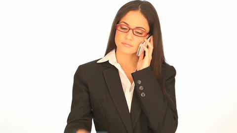Businesswoman doing telephone banking Stock Video Footage