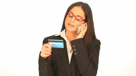Businesswoman doing telephone banking Footage