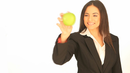 Attractive businesswoman with an apple Footage