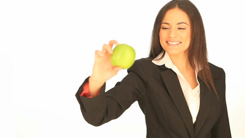 Attractive businesswoman with an apple Stock Video Footage