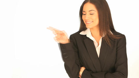 Laughing businesswoman pointing to the side Stock Video Footage