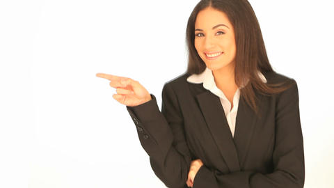 Laughing businesswoman pointing to the side Footage