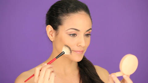 Beautiful woman applying foundation Stock Video Footage