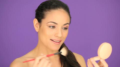 Beautiful woman applying foundation Footage