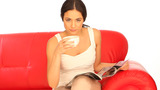 Woman Drinking Tea And Reading stock footage