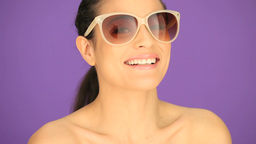 Smiling brunette in sunglasses Stock Video Footage