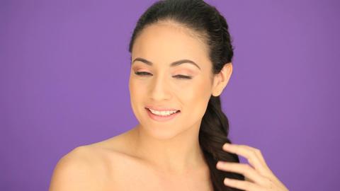 Beautiful brunette brushing her hair Stock Video Footage