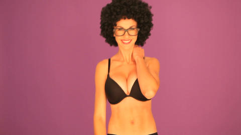 Woman with black afro hairdo waving Stock Video Footage
