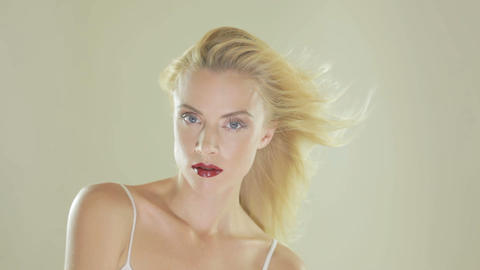 Blonde woman with hair blowing in the wind Stock Video Footage