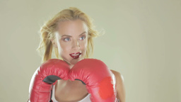 Blonde woman with boxing gloves Stock Video Footage