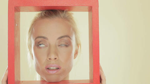 Blonde woman with a red frame Stock Video Footage
