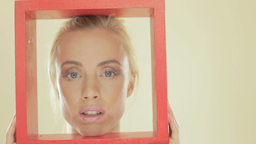Blonde woman with a red frame Footage