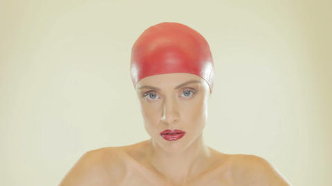 Blonde woman wearing red swimming cap Footage
