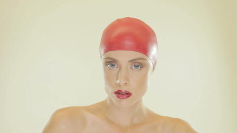 Blonde woman wearing red swimming cap Stock Video Footage