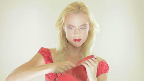 Beautiful blonde woman with a red handbag Stock Video Footage