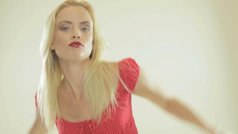 Beautiful blonde woman dancing Stock Video Footage