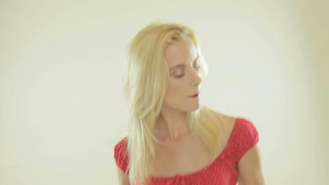 Beautiful blonde woman dancing Footage