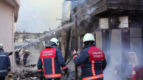 ISTANBUL, TURKEY - FEBRUARY 2012: fire in wooden house Stock Video Footage
