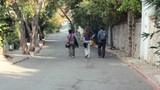 THREE PEOPLE WALKING DOWN Footage
