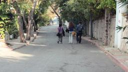 THREE PEOPLE WALKING DOWN Stock Video Footage