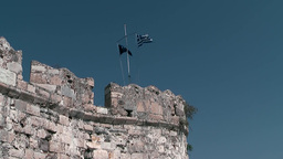 Greece the Aegean Sea Kos 018 historical town wall and national flag Footage