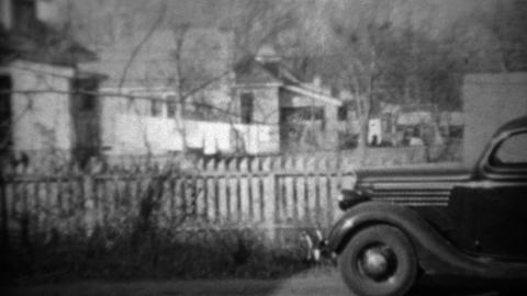 1934: New Plymouth car parked in suburban residential driveway Footage