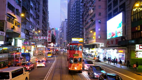 Moving through bright modern city street with illuminated skyscrapers. Hong Kong Footage