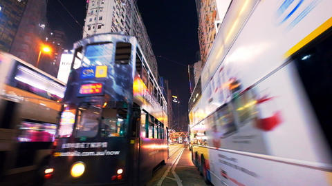 Hong Kong evening street with illuminated buildings and moving transport Footage