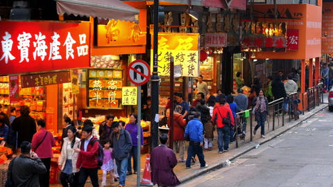 HONG KONG - JAN 17, 2015: Driving through modern city crowded street with shops, Footage