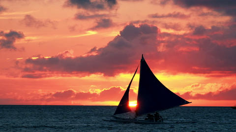 Tropical sunset. Sail boats silhouettes at horizon. Boracay island, Philippines Footage