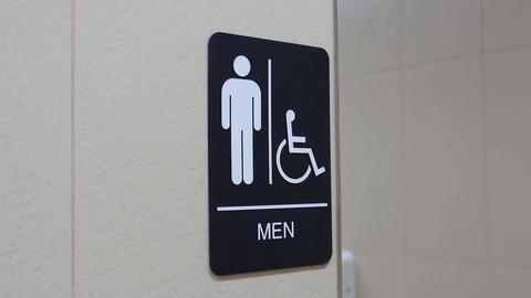 Motion of man and disable washroom logo on wall Footage