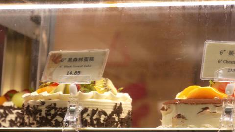 Motion of display birthday cakes inside fridge Live Action