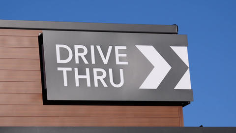 Motion of drive thru on building with blue sky background Footage