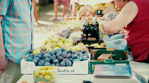 PULA, CROATIA - AUGUST 4, 2017. Vendor and customer at local farmers market Footage