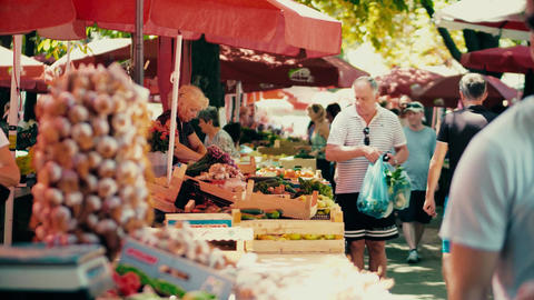 PULA, CROATIA - AUGUST 4, 2017. People buying fresh vegetables at local Footage