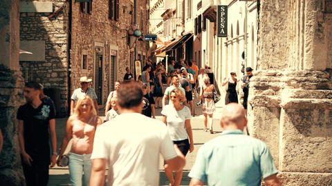 PULA, CROATIA - AUGUST 4, 2017. Crowded tourist street on a hot summer day Footage