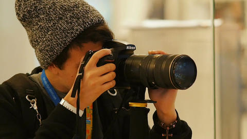 Hipster Photographer Shoots on Professional Camera Footage