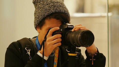 Hipster Photographer with Piercing Smiles to Camera Footage