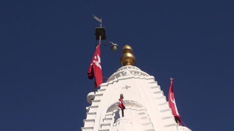 hindu temple tower and red flags in Rajasthan, Jodphur fort Footage