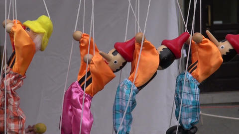 wooden colorful dolls puppets marionette in market Footage