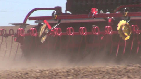 agriculture tractor on farm field seeding grains Footage