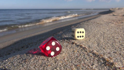 lucky game dices with number six points on sea beach sand Footage