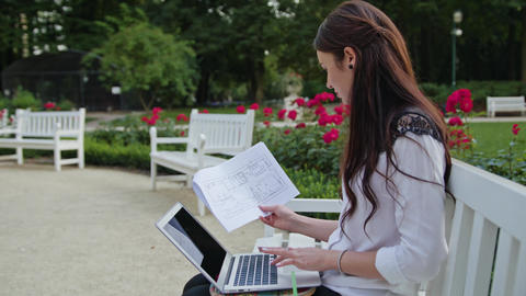 Lady Sitting in the Park, Using Laptop. Data Entry Footage